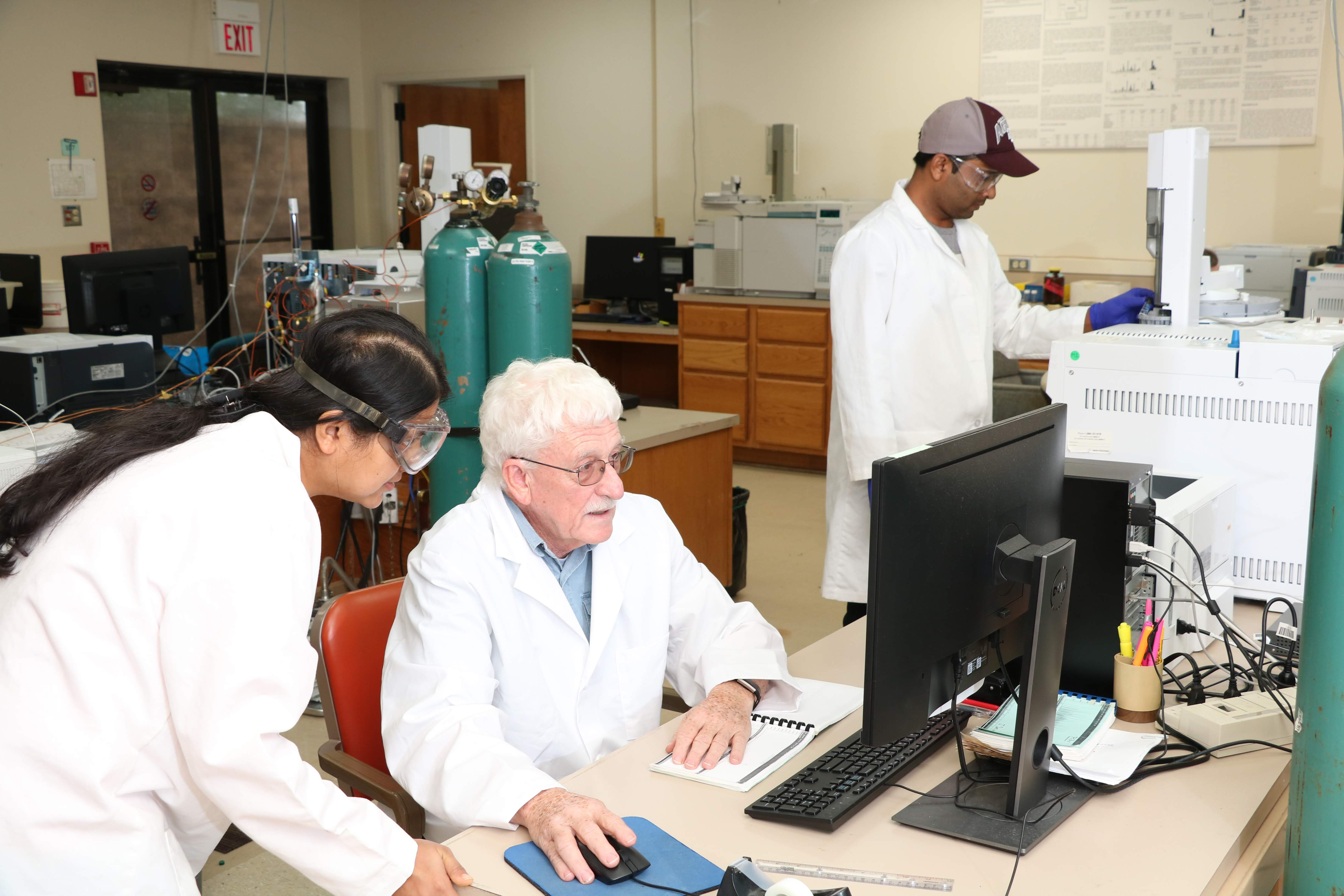 Terry Wade and students in a GERG lab